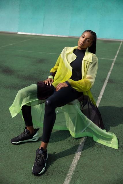 Catsuit: Nike x Matthew Williams, jas: Dries van Noten, schoenen:
