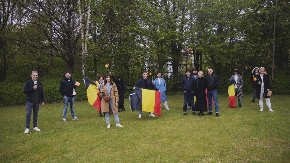 De Belgische delegatie poseert voor een groepsfoto.